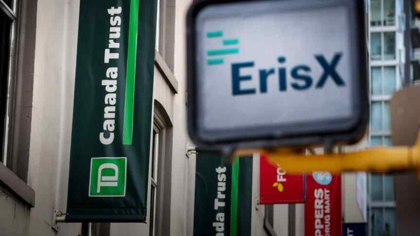 ErisX logo and name on white billboard in front of Canada Trust building