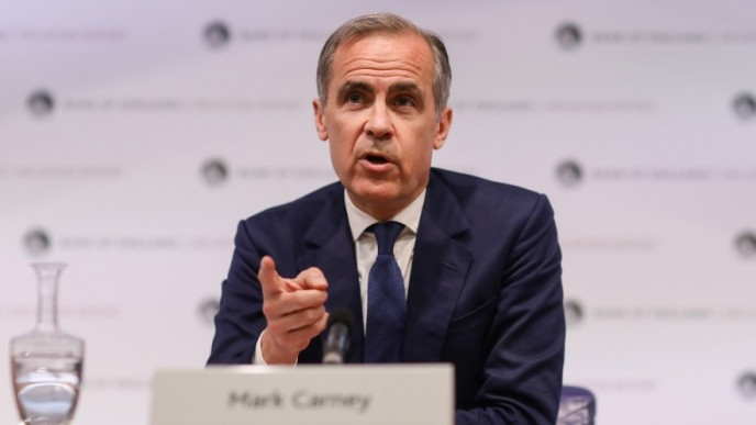 MArk Carney in dark-blue suit and tie, speaking at the G20 meeting, hand raised, pointing finger at camera