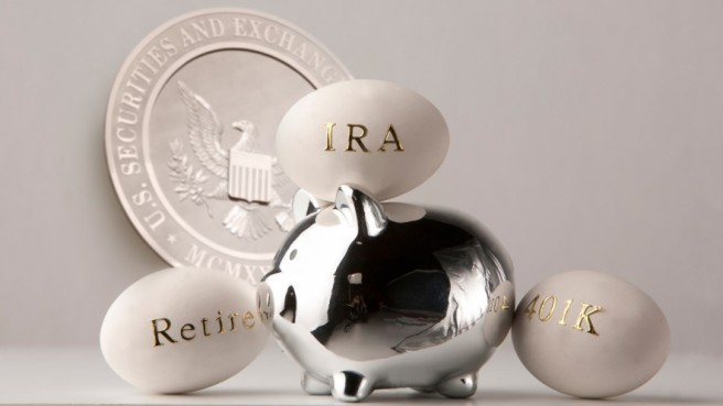 white eggs inscribed in gold (IRA, Retirement, 401K), on and on both sides of a silver piggy bank, in the background a silver plate with SEC logo
