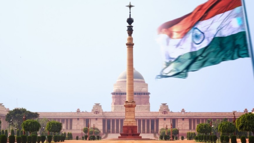 -Indian flag waving in front of Indian government building