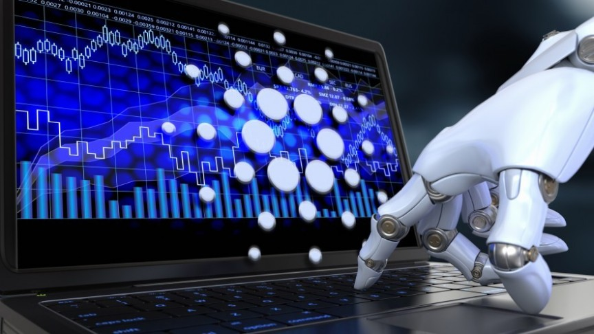 robotic white hand pointing at screen showing blue graphs and Cardano logo