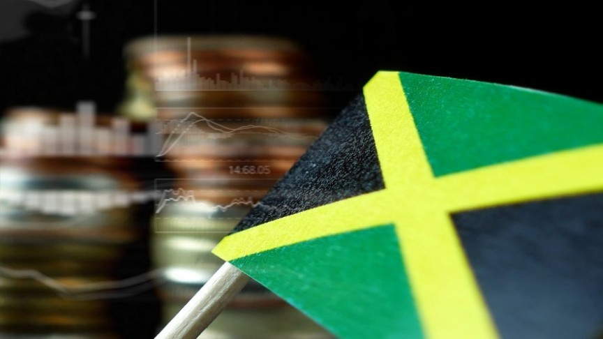 -Jamaican flag, blurry stacks of coins